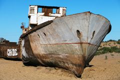Boats in desert around Moynaq - Aral sea or Aral lake - Uzbekistan - asia. Boats in desert around Moynaq, Muynak or Moynoq - Aral sea or Aral lake - Uzbekistan Stock Image