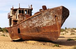 Boats in desert around Moynaq - Aral sea or Aral lake - Uzbekistan - asia Royalty Free Stock Photography