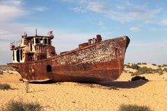 Boats in desert around Moynaq - Aral sea or Aral lake - Uzbekistan - asia Royalty Free Stock Image