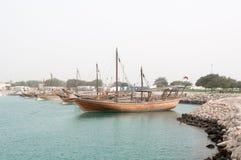 Boats (Dhow) mooring at Doha Corniche, Qatar stock images