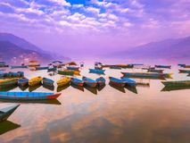 The Boats with different colors,the Sky reflection in the water royalty free stock images