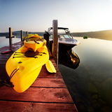 Boats on dock. Sunrise over kayaks and boats tied up awaiting summer fun Royalty Free Stock Image