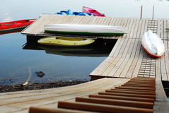 Boats on the dock. Some boats on a wooden dock Stock Photos