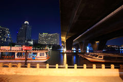 Boats at dock on Chao Phraya River Stock Photos