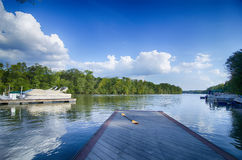 Boats at dock on a lake with blue sky Royalty Free Stock Photography