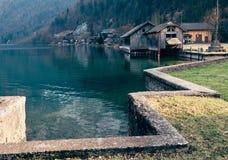 Boats dock on the mountain lake in Hallstatt, Austria Stock Photo