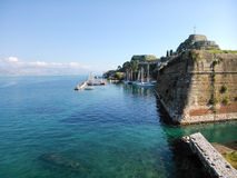 Boats in the dock. And the old fortress in the background in Corfu island Greece Stock Images