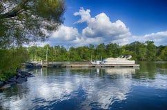Boats at dock onTeam Logo Fat Dotsa lake with blue sky Royalty Free Stock Photo