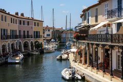 Boats docked along a canal in touristic place Stock Photo