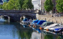 Boats docked along a Copenhagen canal royalty free stock photos