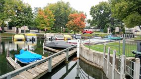 Boats Docked by Dam in Lake Geneva, Wisconsin. Boats docked along piers near the dam in Lake Geneva, Wisconsin on an early fall day stock photography