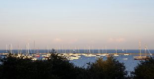 Boats docked, anchored and moored in a Harbor stock photos
