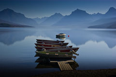 Boats docked on a calm blue mountain lake royalty free stock photo