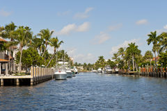 Boats docked on canal. Yachts and luxury boats docked at waterfront homes on a Florida canal Stock Photography