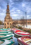Boats docked at the canal with norht tower at de bottom Royalty Free Stock Image