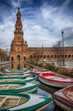 Boats docked at the canal with norht tower at de bottom Royalty Free Stock Photos