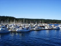 Boats docked in harbor Stock Photo