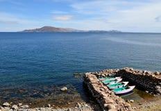 Boats docked on Lake Titicaca Shore Stock Image