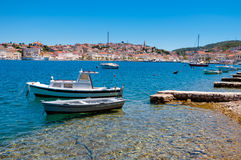 Boats docked on little beach in Mali Losinj Royalty Free Stock Photography