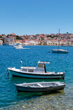 Boats docked on little beach in Mali Losinj Royalty Free Stock Photo