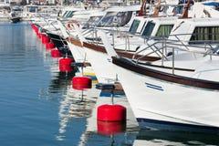 Boats docked at a marina in Liguria, Italy Royalty Free Stock Photos