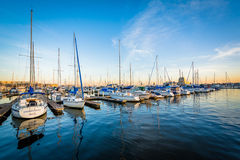 Boats docked in a marina at sunset in Canton, Baltimore, Marylan Stock Photography