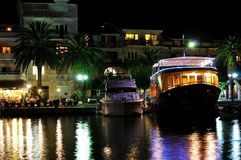 Boats docked at night in port of Podgora Royalty Free Stock Photography