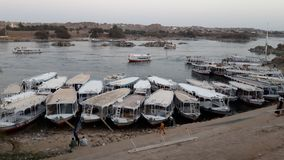 Boats docked at a Nubian village in Egypte along the Nile. Egypt emerged as one of the world`s first nation states in the tenth millennium BC. Considered a Royalty Free Stock Photos