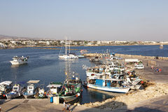 Boats docked in Paphos harbour, Cyprus. Paphos City, Cyprus - JULY 16, 2015: Boats docked in Paphos harbour in the afternoon royalty free stock photos