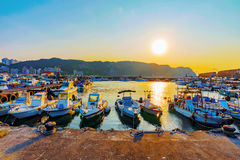 Boats docked in a small fishing town. During sunset in Taiwan Royalty Free Stock Image