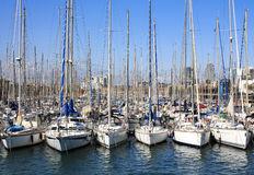 Boats docked. SPAIN. BARCELONA - MAY 11, 2013: Boats docked in the Port Vell on the blue sky background. Barcelona port for more than two thousand years Stock Image