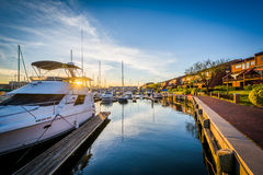 Boats docked at sunset, in Canton, Baltimore, Maryland. Stock Photography