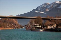 Boats docked under a bridge in Interlaken, Switzerland Stock Photo