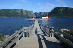 Boats Docked at Western Brook Pond Stock Photography