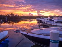Boats docked at the yacht club early morning before dawn stock images