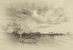 Boats docking at foreshore Stock Images