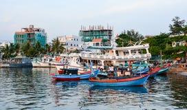 Boats docking on Hon Khoi pier in Khanh Hoa, Vietnam Royalty Free Stock Photo