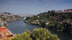 Boats on Douro river in Porto, Portugal. Porto, Portugal - May 8, 2017: Boats on Douro river in a spring day. Duero is one of the major rivers of the Iberian stock video footage