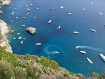 Boats drifting in a calm bay Stock Image