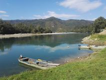 Boats on Drina river, Serbia. Boats on Drina river and mountain in background, Serbia stock photography