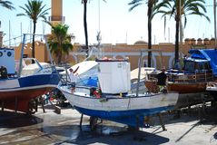 Boats in dry dock, Fuengirola. Traditional Spanish fishing boats in dry dock, Fuengirola, Malaga Province, Andalusia, Spain, Western Europe Stock Images