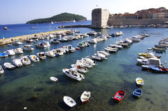 Boats. In dubrovnik port, tower in the background Stock Image