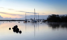 Boats and early morning mist. At Christchurch harbour in Dorset Stock Images