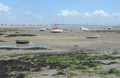 Boats and ebb tide Royalty Free Stock Image