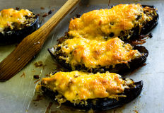 Boats of eggplant zucchini stuffed with meat, rice, tomato and mushrooms with grated cheese Royalty Free Stock Image