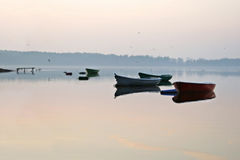 Boats in Elk Lake, tranquil, evening autumn. Royalty Free Stock Image