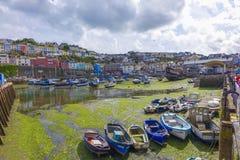 Boats in empty harbor harbour Brixham Devon England UK Royalty Free Stock Images