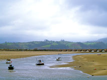 Boats on a estuary on a cloudy day Royalty Free Stock Photography
