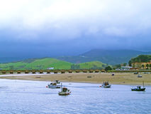 Boats on a estuary on a cloudy day Royalty Free Stock Photo