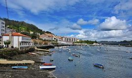 Boats in the estuary at Puentedeuma in Galicia, Spain royalty free stock photo